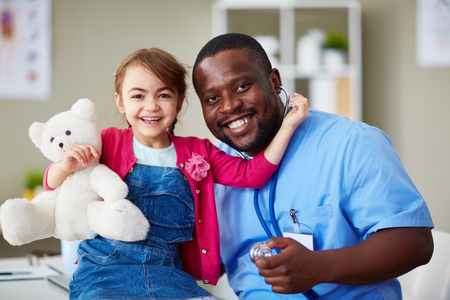 child patient: Portrait of a cute little girl and her doctor at hospital