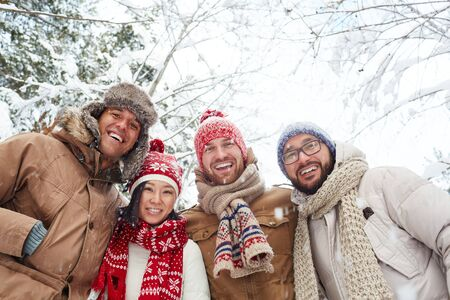 friendly people: Group of friendly people looking at camera in natural environment in winter Stock Photo