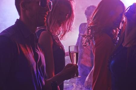 nightclub party: Cheerful friends enjoying party in nightclub Stock Photo
