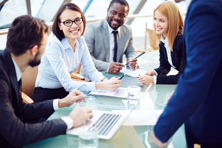 working: Business team discussing together business plans Stock Photo