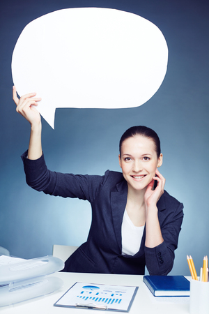 speech bubble: Smiling businesswoman holding white sigh over her head
