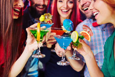 entertainment event: Young people having fun at party with cocktails