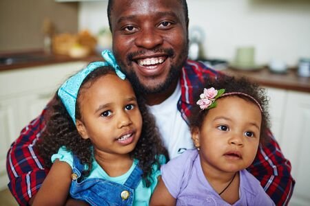 africanamerican: Happy African-American man and his two cute daughters Stock Photo