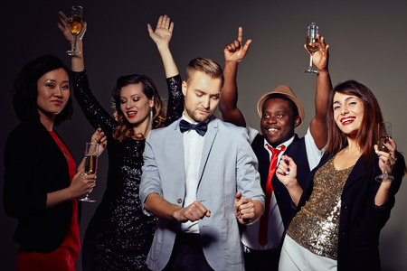 party night: Smart clubbers with champagne having night party Stock Photo