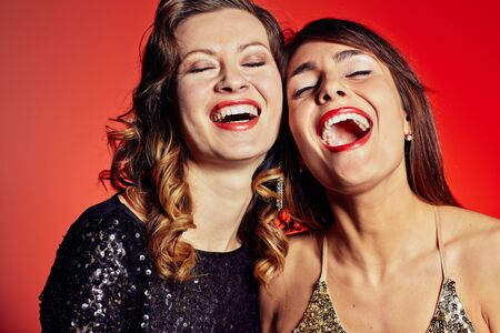 clubber: Happy young and posh women laughing