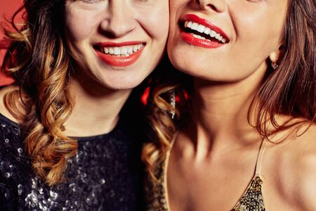 toothy smiles: Happy young women with toothy smiles Stock Photo