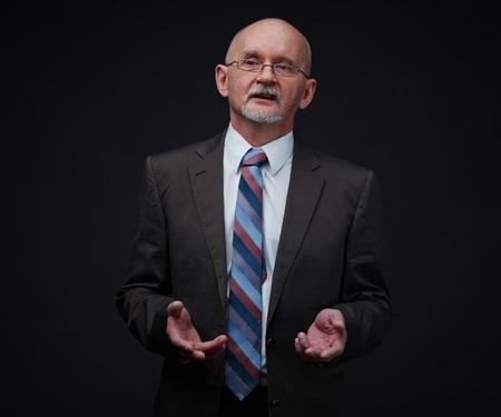 mature businessman: Mature businessman explaining his viewpoint