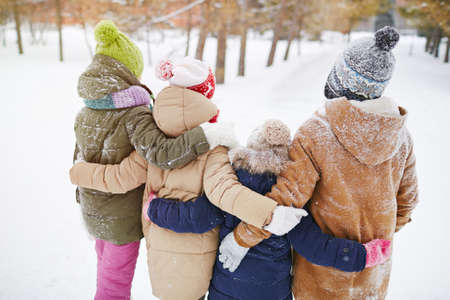 jungle boy: Little friends standing in embrace in winter forest