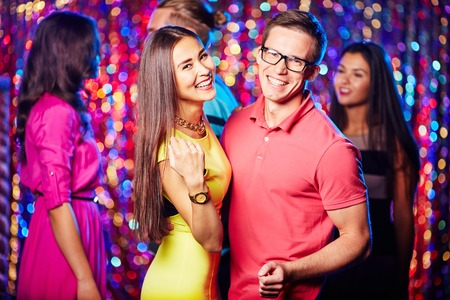 amorous: Amorous couple dancing in night club at party Stock Photo