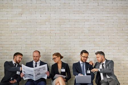 vacancies: Modern business people discussing new vacancies Stock Photo