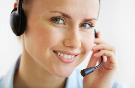 customer support: Portrait of smiling female customer support phone operator