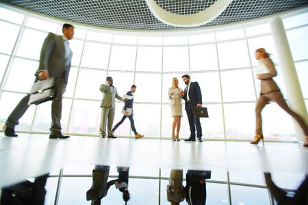 people interacting: Business people interacting in modern office Stock Photo