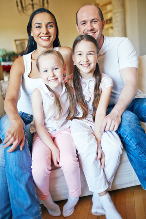 guy portrait: Beautiful family of four smiling at camera