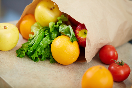 organics: Paperbag with fruits and vegetables Stock Photo