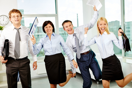 ecstatic: Ecstatic white collar workers having fun in office Stock Photo
