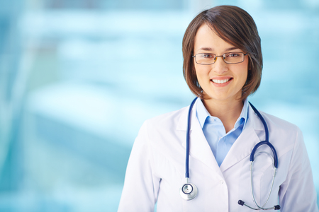 clinician: Young clinician in uniform looking at camera with smile Stock Photo