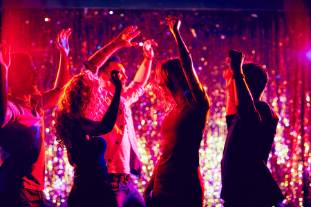 clubber: Group of young people dancing at party Stock Photo