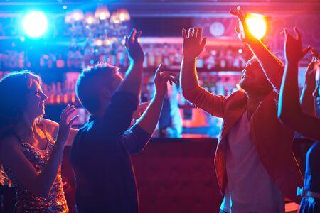 disco: Happy dancers enjoying disco in night club