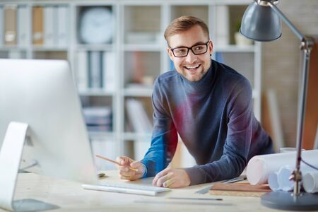 people office: Happy engineer or designer at workplace Stock Photo