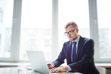 technology career: Confident businessman networking in office