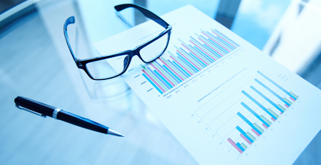 statistic: Group of business objects on workplace Stock Photo