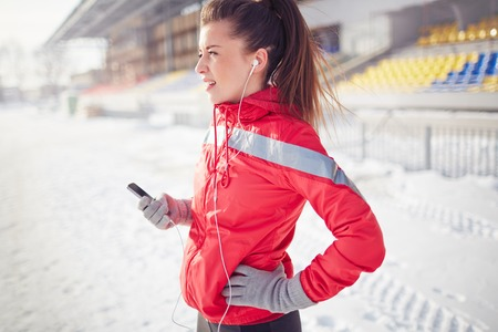 breath taking: Young sporty woman taking a breath during jogging Stock Photo