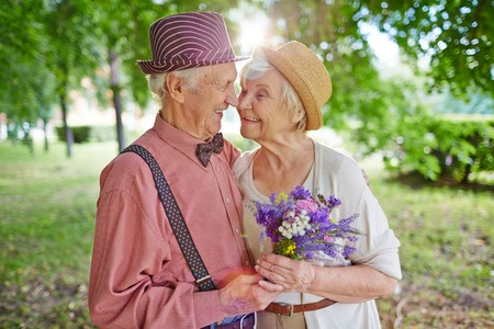 Happy elderly couple in love enjoying summer day together