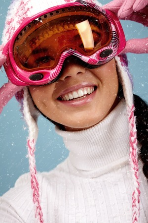 ski goggles: Portrait of smiling woman with ski goggles Stock Photo
