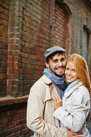 autumn young: Portrait of smiling couple embracing outdoors