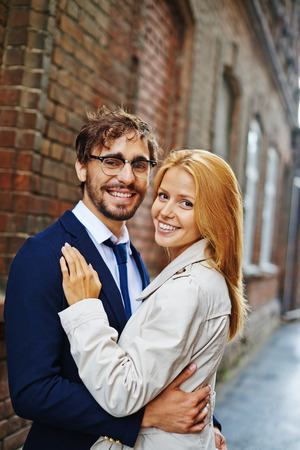 couples hug: Lovely couple embracing in autumn day Stock Photo