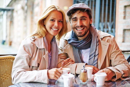 boy lady: Happy couple drinking coffee together Stock Photo
