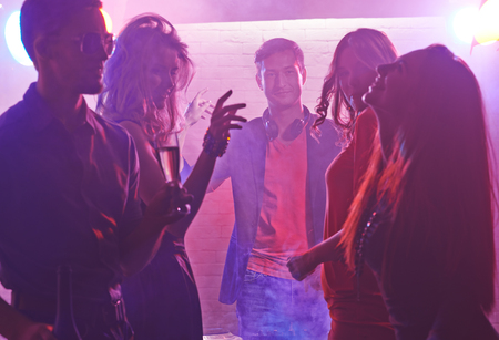 young group: Group of young people dancing at the disco club