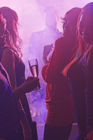 champagne flutes: Girls with champagne flutes dancing at party