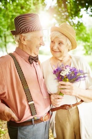 couples hug: Happy elderly seniors couple in park Stock Photo