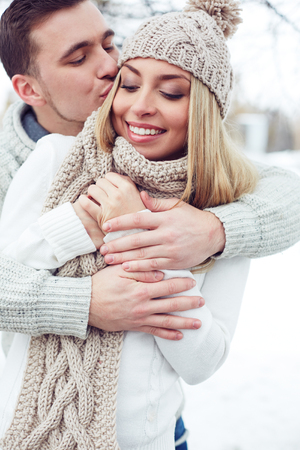 kiss love: Young man embracing and kissing his girlfriend Stock Photo