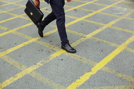 hurrying: Legs of businessman hurrying for work Stock Photo