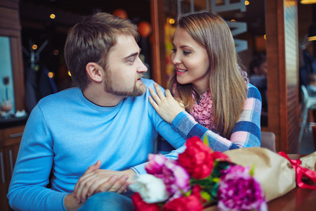 amorous: Amorous couple in casual-wear relaxing in cafe