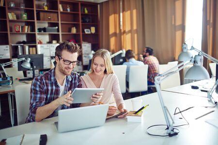 modern office: Two modern employees networking in office