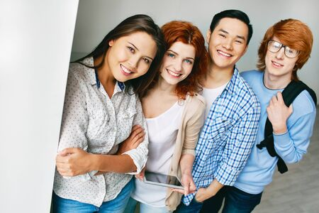asian adult: Portrait of smiling college students standing together and smiling Stock Photo