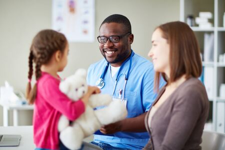 medical people: Smiling doctor examining his little patient Stock Photo