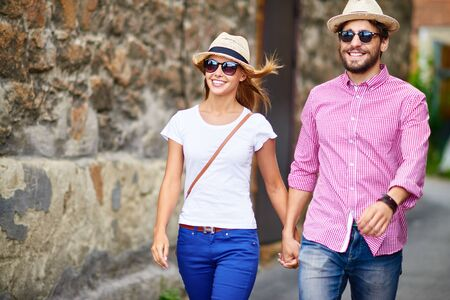 urban environment: Couple of modern tourists sightseeing in urban environment