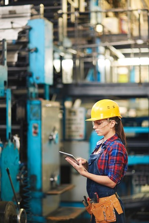 touchpad: Young engineer with touchpad working at modern plant Stock Photo