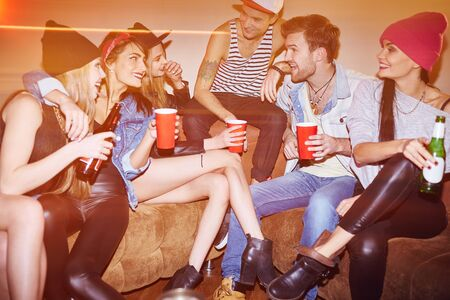 clubber: Happy young people with drinks relaxing in bar Stock Photo