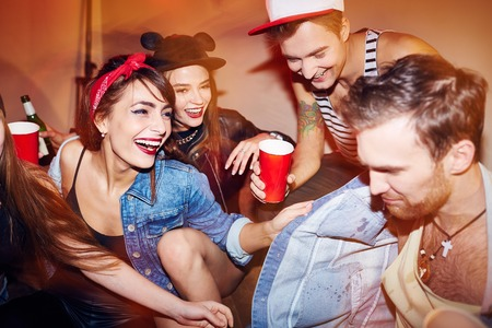 clubber: Happy young people in casual-wear relaxing in bar