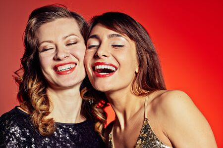smile face: Elegant young women laughing together