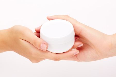 handcare: Female hands with jar of body lotion