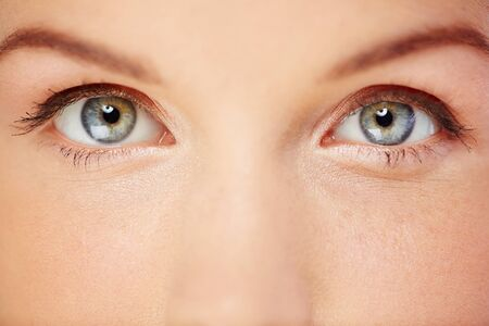 Close up of beautiful female grey eyes