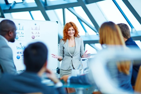 woman: Business people having board meeting in modern office Stock Photo
