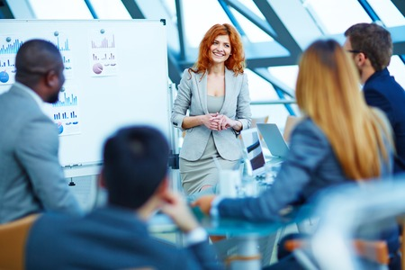 Smiling businesswoman presenting business project to her partners Stock Photo - 50673377