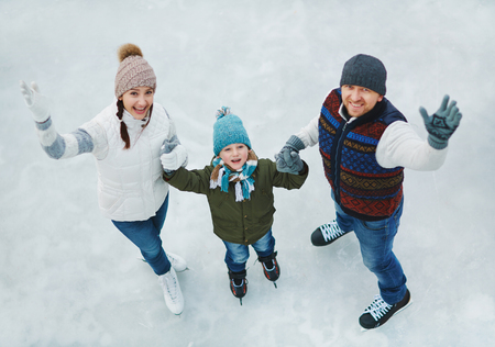 Family portrait of three people in skating rink